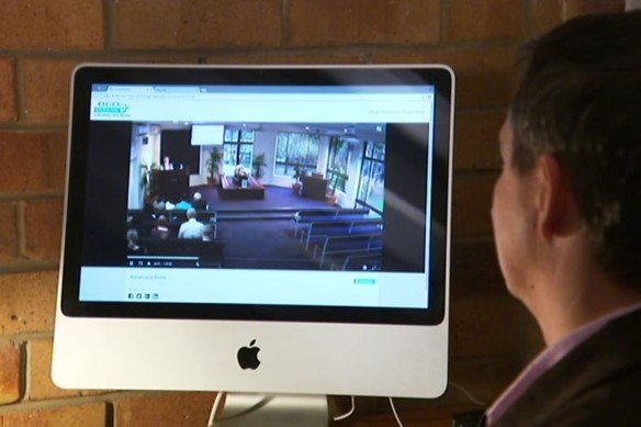 Family Member watching a Virtual Funeral service by Newhaven Funerals